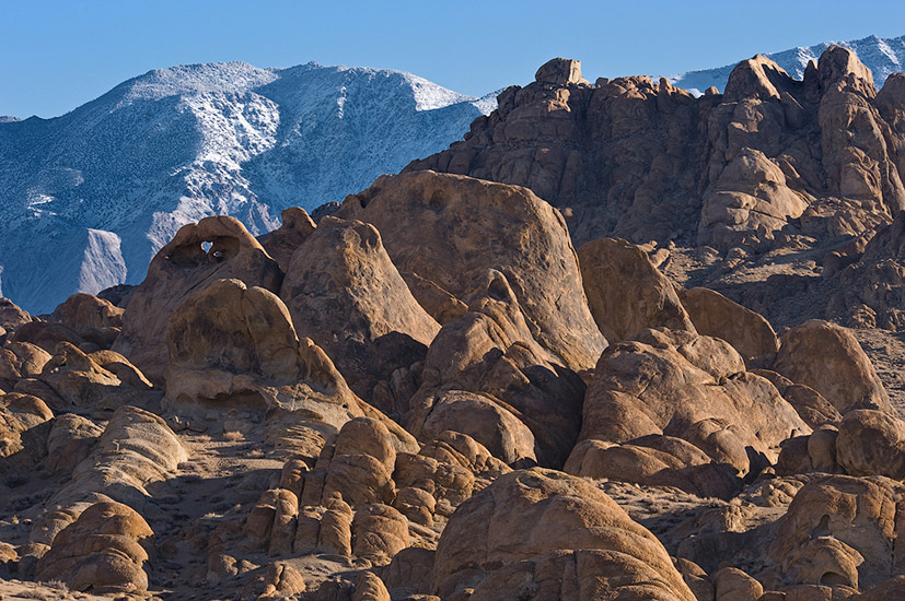 Rigid boulders, Heart Arch and Inyo Mountains. Alabama Hills near Lone Pine, Eastern Sierra, California, USA.