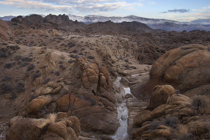Rainwater flows on the floor of the small canyon. Alabama Hills near Lone Pine, Eastern Sierra, California, USA.