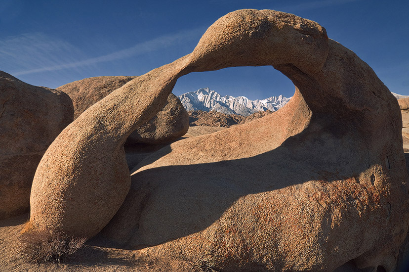 Mobius Arch frames Lone Pine Peak and Mount Whitney. Alabama Hills near Lone Pine. Eastern Sierra, California, USA.