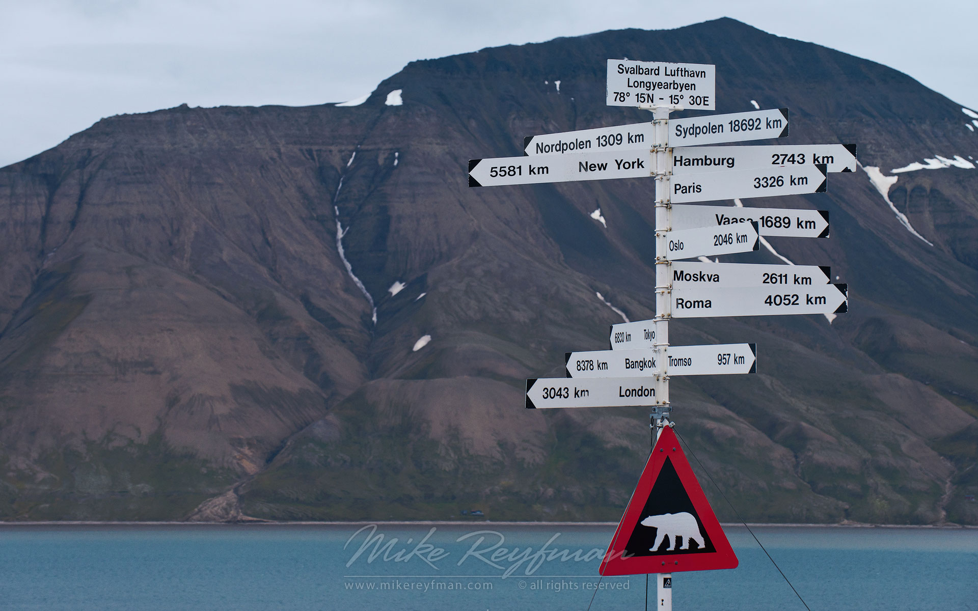 Polar Bear road sign ?nd signposts to destinations around the world at Svalbard Airport. Longyearbyen, Svalbard (Spitsbergen) Archipelago, Norway. - Arctic-Landscape-Svalbard-Spitsbergen-Norway - Mike Reyfman Photography