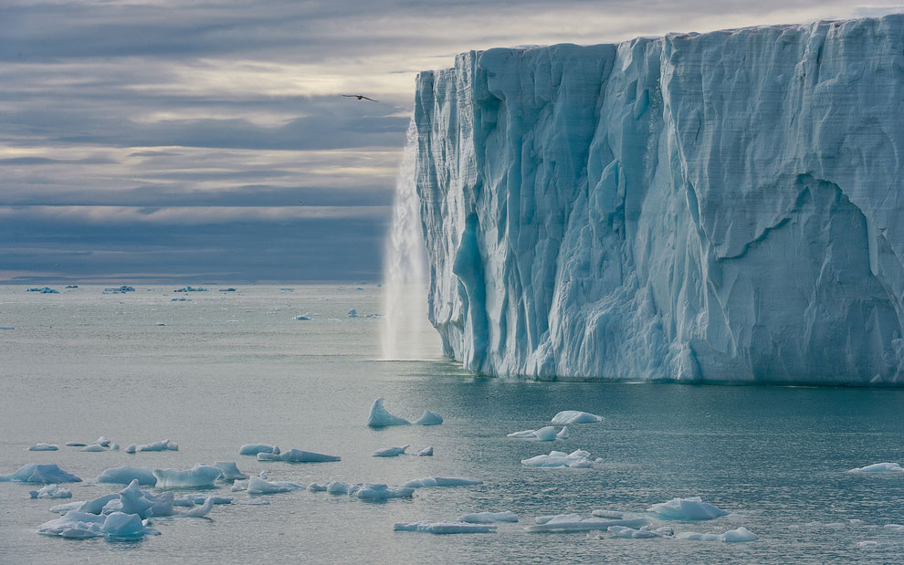 Meltwater waterfall flowing off the Austfonna Ice Cap. Svalbard (Spitsbergen) Archipelago, Norway.