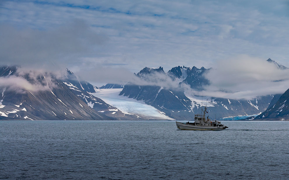 Boat, Glaciers and Mountains. Svalbard (Spitsbergen) Archipelago, Norway.