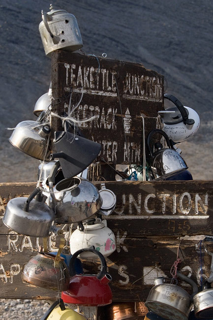 Teakettle Junction sign, adorned with tea kettles. Teakettle Junction, Death Valley National Park, California. - Death-Valley-National-Park-California-USA - Mike Reyfman Photography