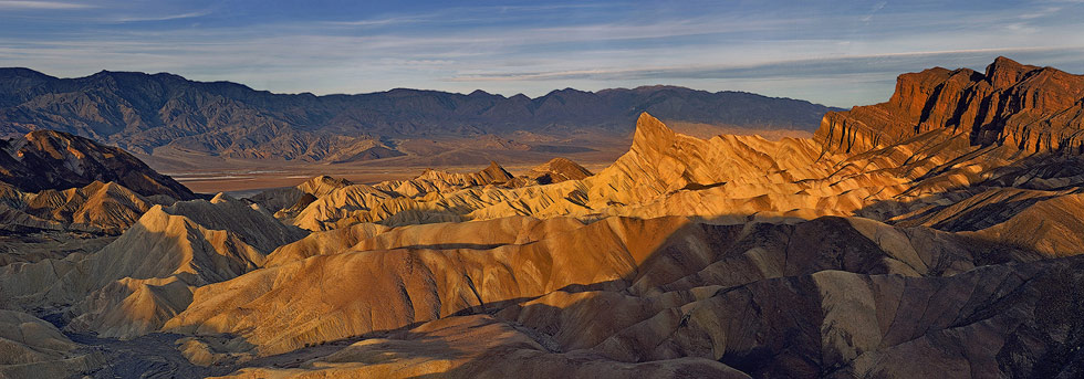 Zabriskie Point. Panoramic view of Manly Beacon, Badlands, Badwater Basin and Panamint Range from Zabriskie Point.