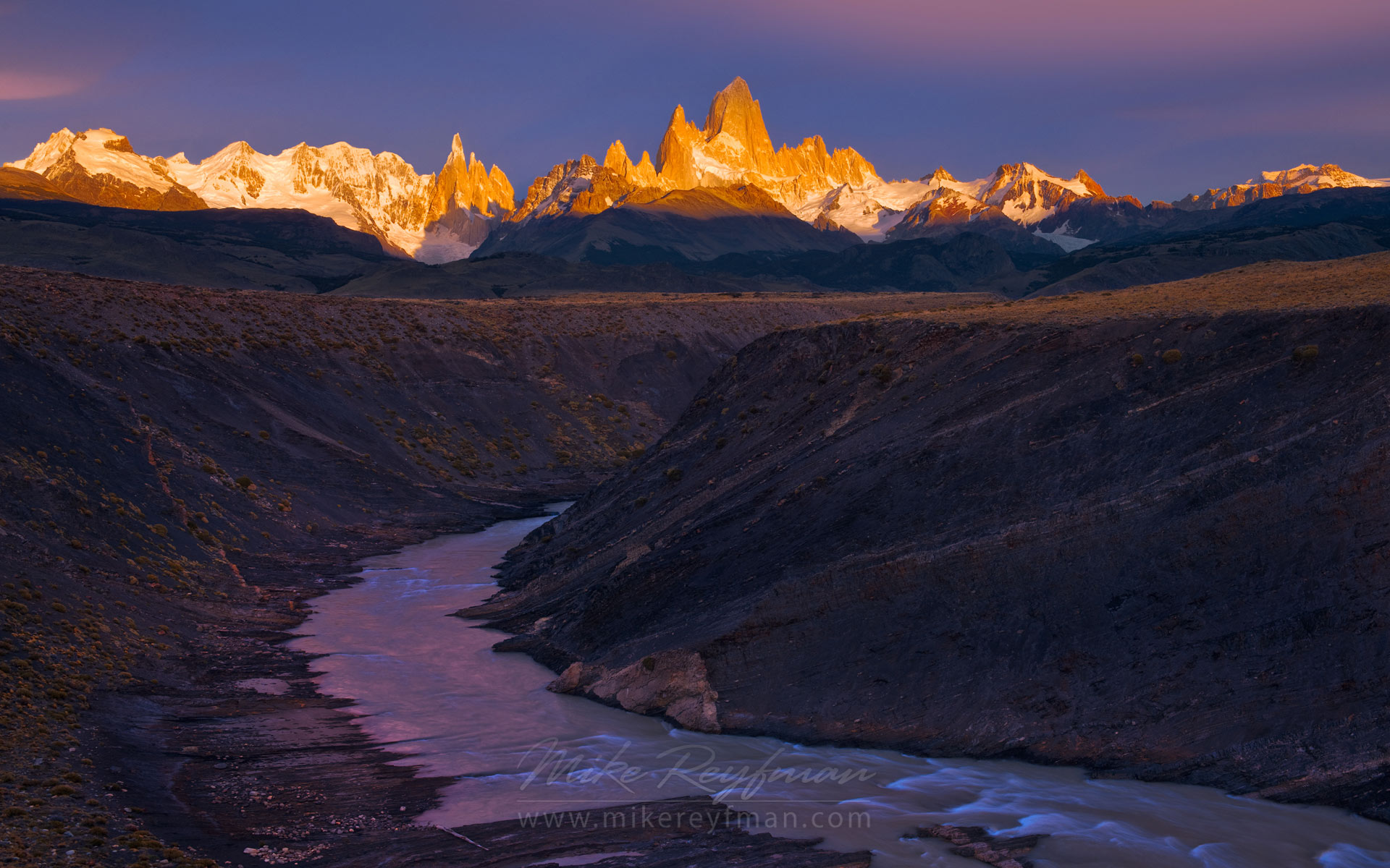 Mountain magic. Fitzroy and Cerro Torre massifs at Sunrise from Las Vueltas River canyon overlook. Patagonian Andes, Santa Cruz, Argentina. - Fitzroy-Cerro-Torre-Perito-Moreno-Patagonia-Argentina - Mike Reyfman Photography