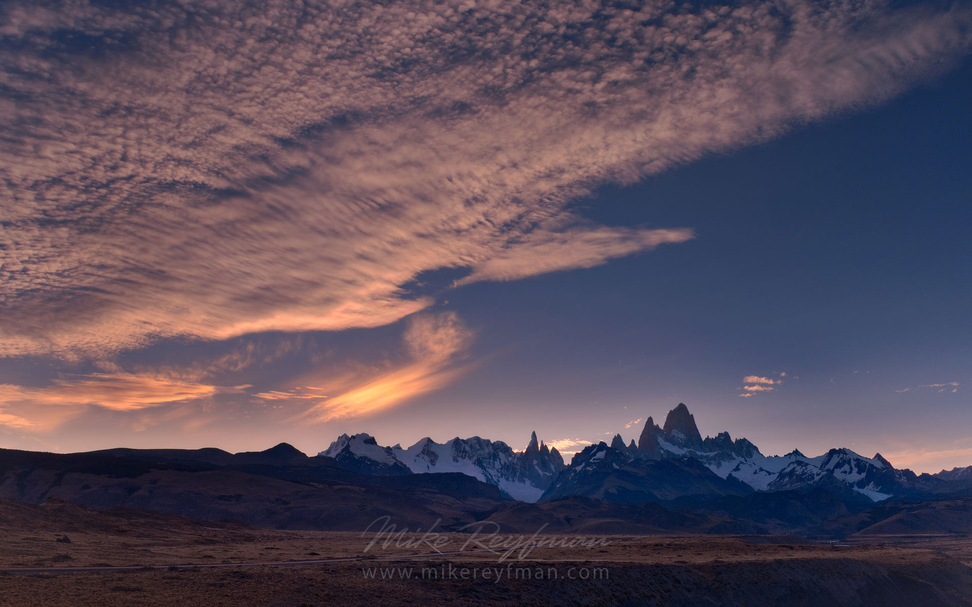 Windy twilight. Fitzroy and Cerro Torre massifs after sunset from Las Vueltas River canyon overlook. Patagonian Andes, Santa Cruz, Argentina. - Fitzroy-Cerro-Torre-Perito-Moreno-Patagonia-Argentina - Mike Reyfman Photography