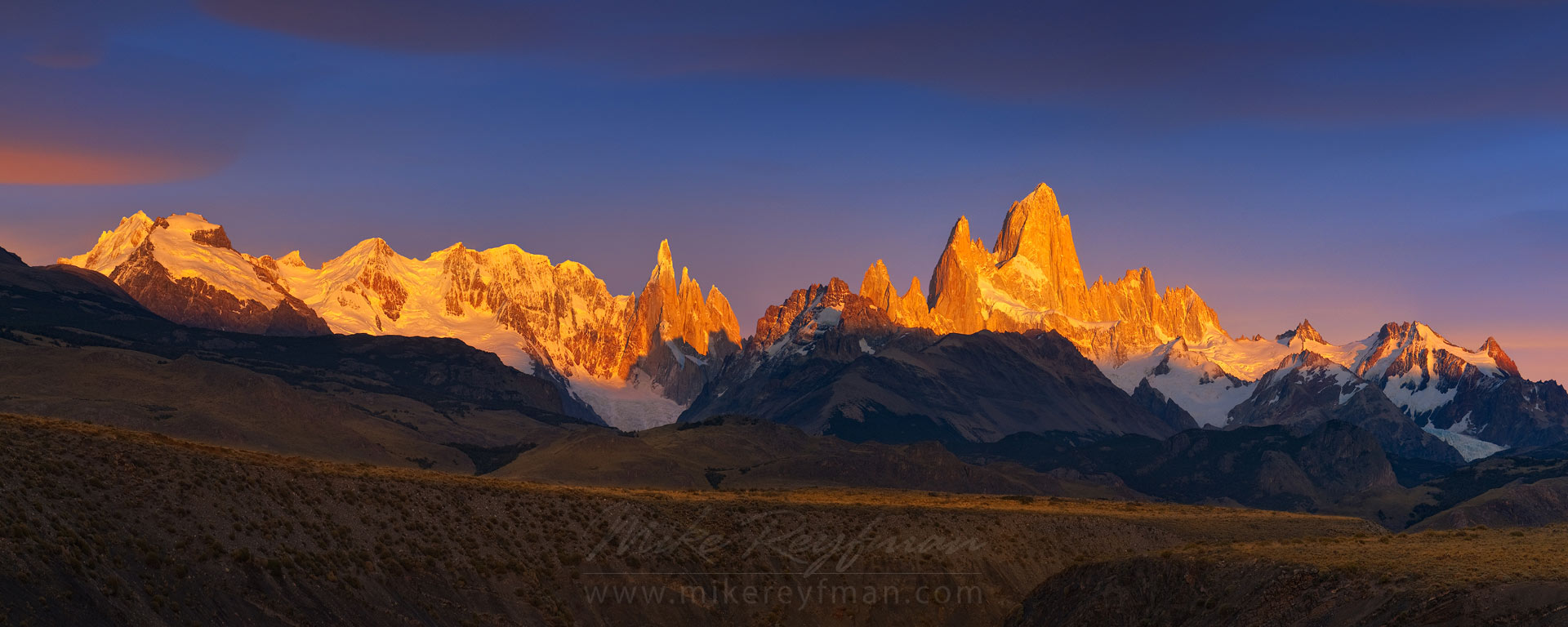 First Light. Fitzroy and Cerro Torre massifs at Sunrise from Las Vueltas River canyon overlook. Patagonian Andes, Santa Cruz, Argentina.   - Fitzroy-Cerro-Torre-Perito-Moreno-Patagonia-Argentina - Mike Reyfman Photography