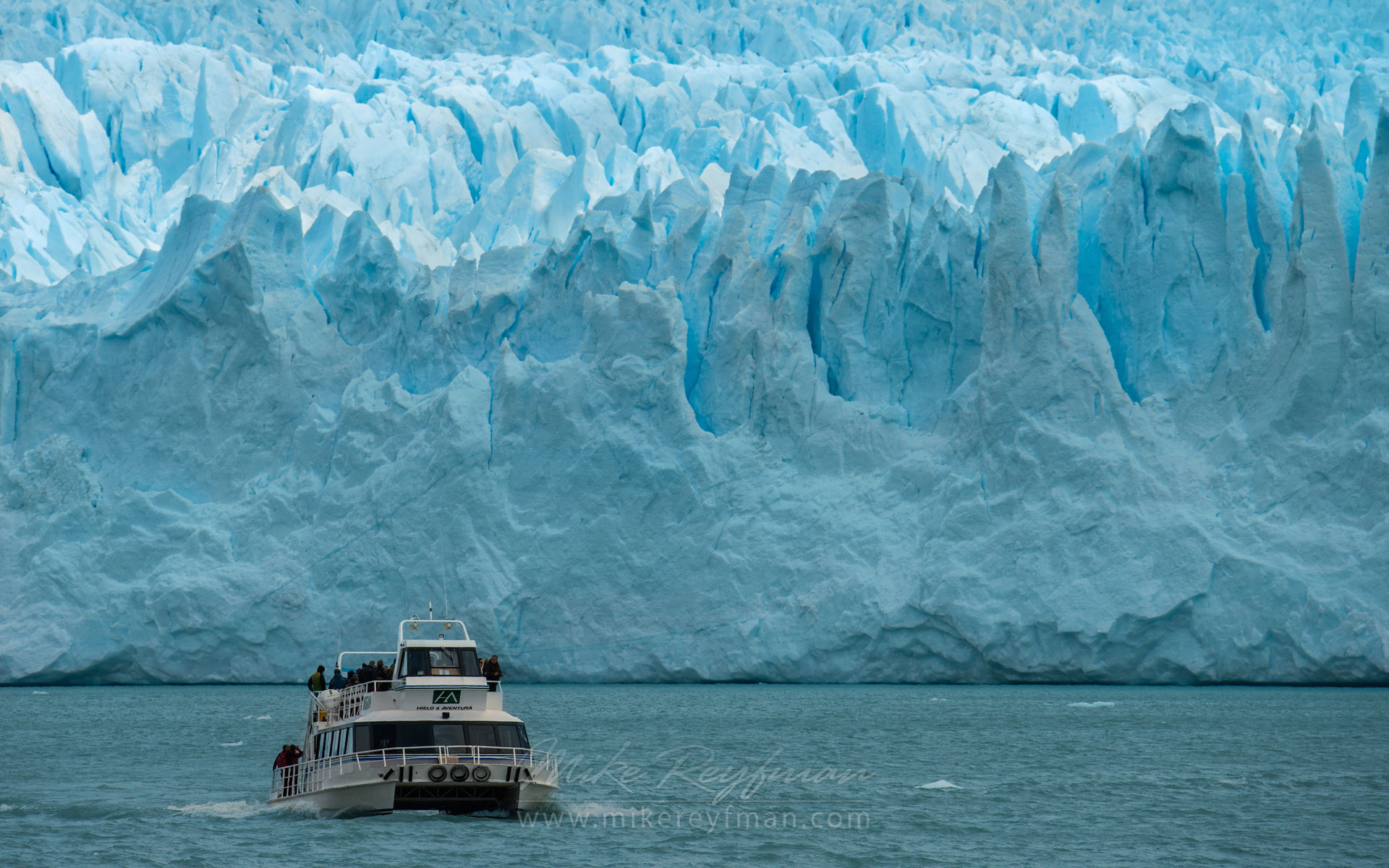 Tourist boat on Lago Argentino going back from Perito Moreno Glacier. Lago Argentino, Los Glaciares National Park, Patagonia, Argentina. - Fitzroy-Cerro-Torre-Perito-Moreno-Patagonia-Argentina - Mike Reyfman Photography