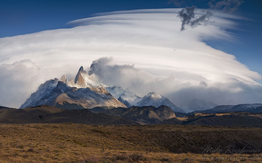 Fitzroy massif, crazy cloud and flying condor. Patagonian Andes, Santa Cruz, Argentina.