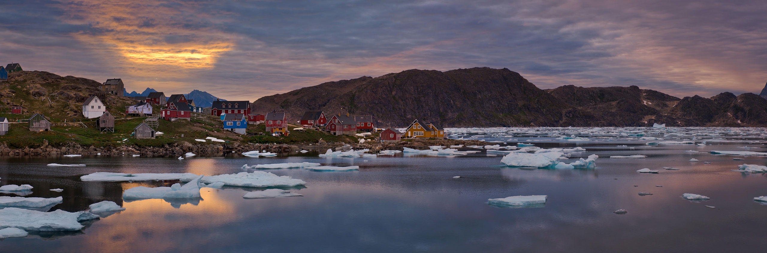 Sunset over settlement of Kulusuk and Torsuut Tunoq sound. Southeastern Greenland. Panoramic. - Greenland-Iceberg-Factory-1 - Mike Reyfman Photography