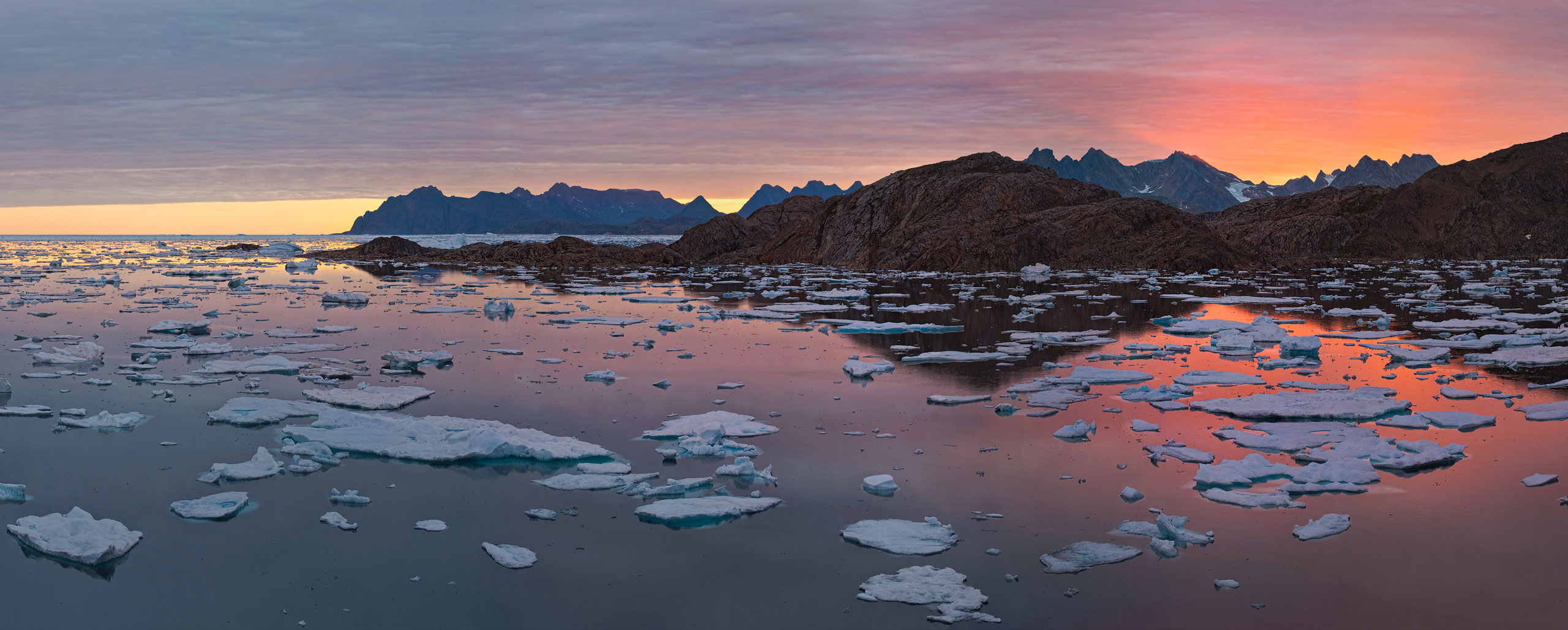 Evening Chime. View from Kulusuk over Torsuut Tunoq sound toward Angmagssalik island at sunset. Southeastern Greenland. - Greenland-Iceberg-Factory-1 - Mike Reyfman Photography