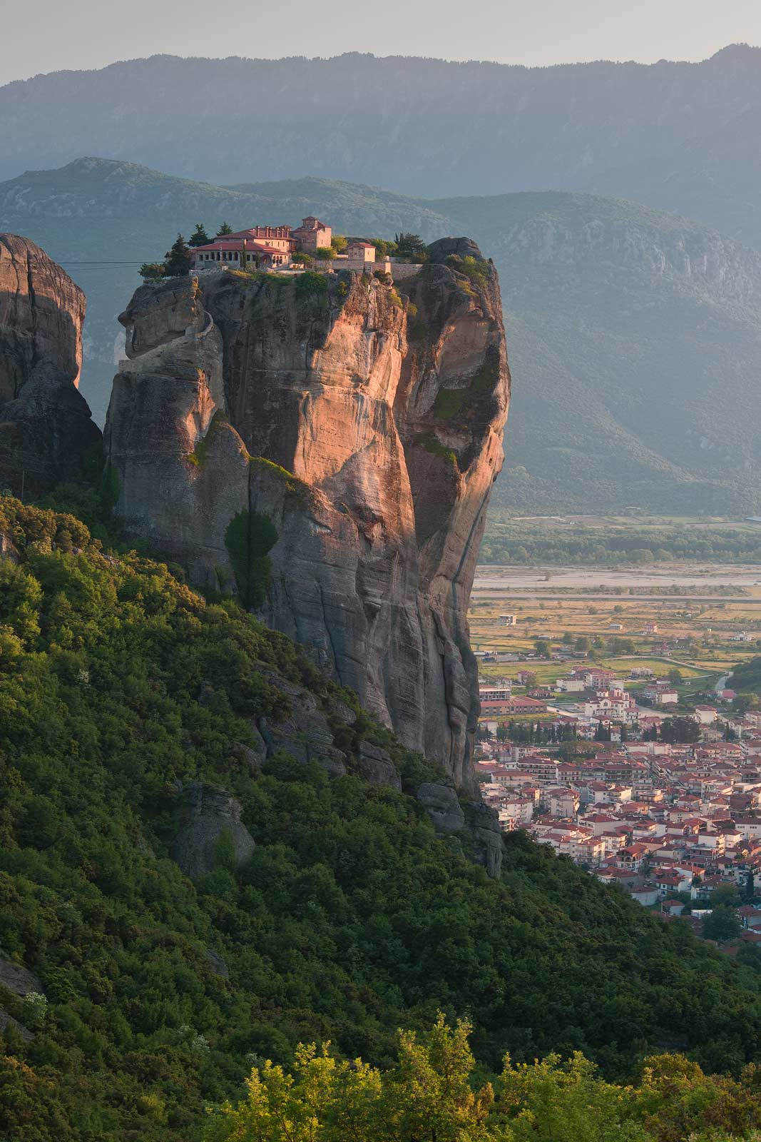 Holy Trinity Monastery (Agia Trias) in the Meteora with the town of Kalambaka on Thessaly valley floor. Greece. - Meteora-Monasteries-Greece - Mike Reyfman Photography