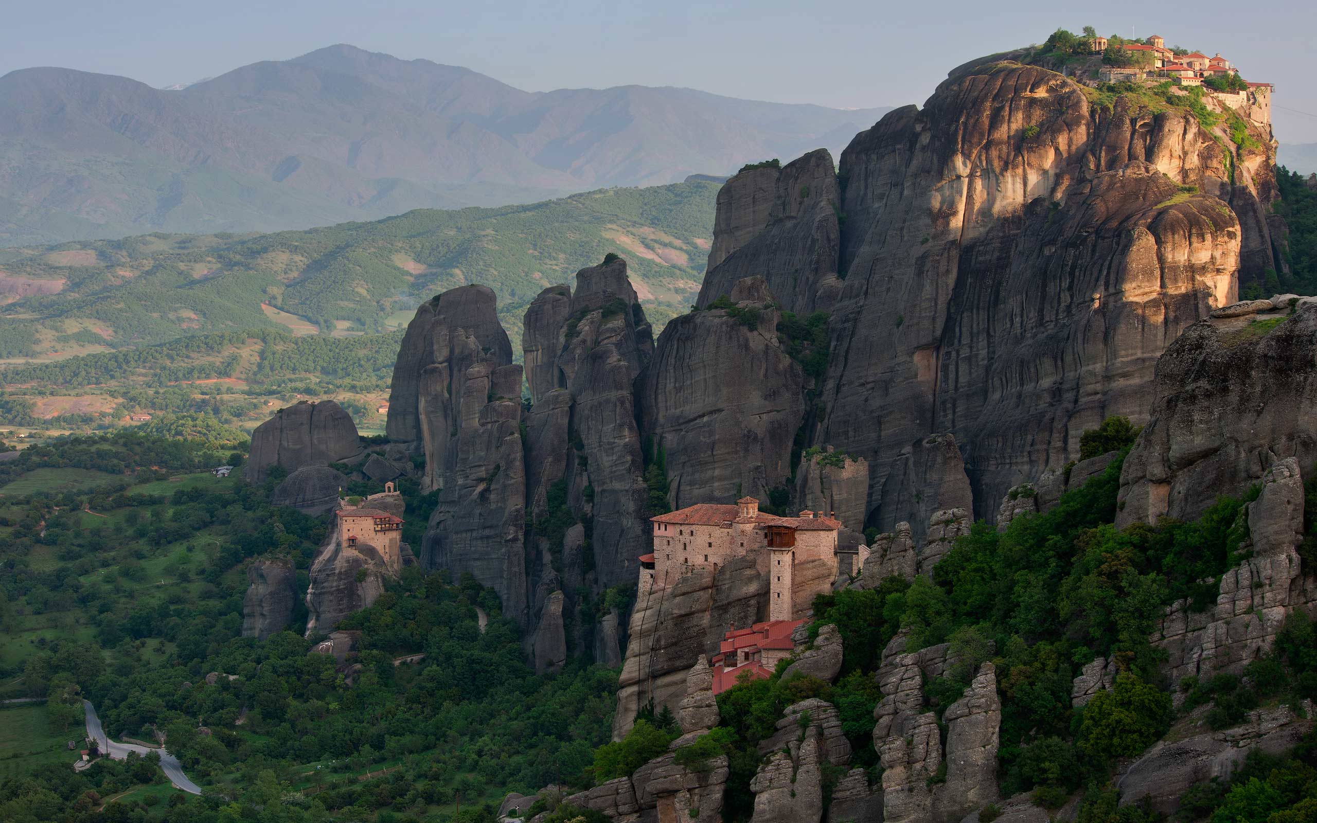 Roussanou, St. Nicholas Anapafsas and Great Meteoron Monasteries at sunrise. Meteora, Thessaly, Greece - Meteora-Monasteries-Greece - Mike Reyfman Photography