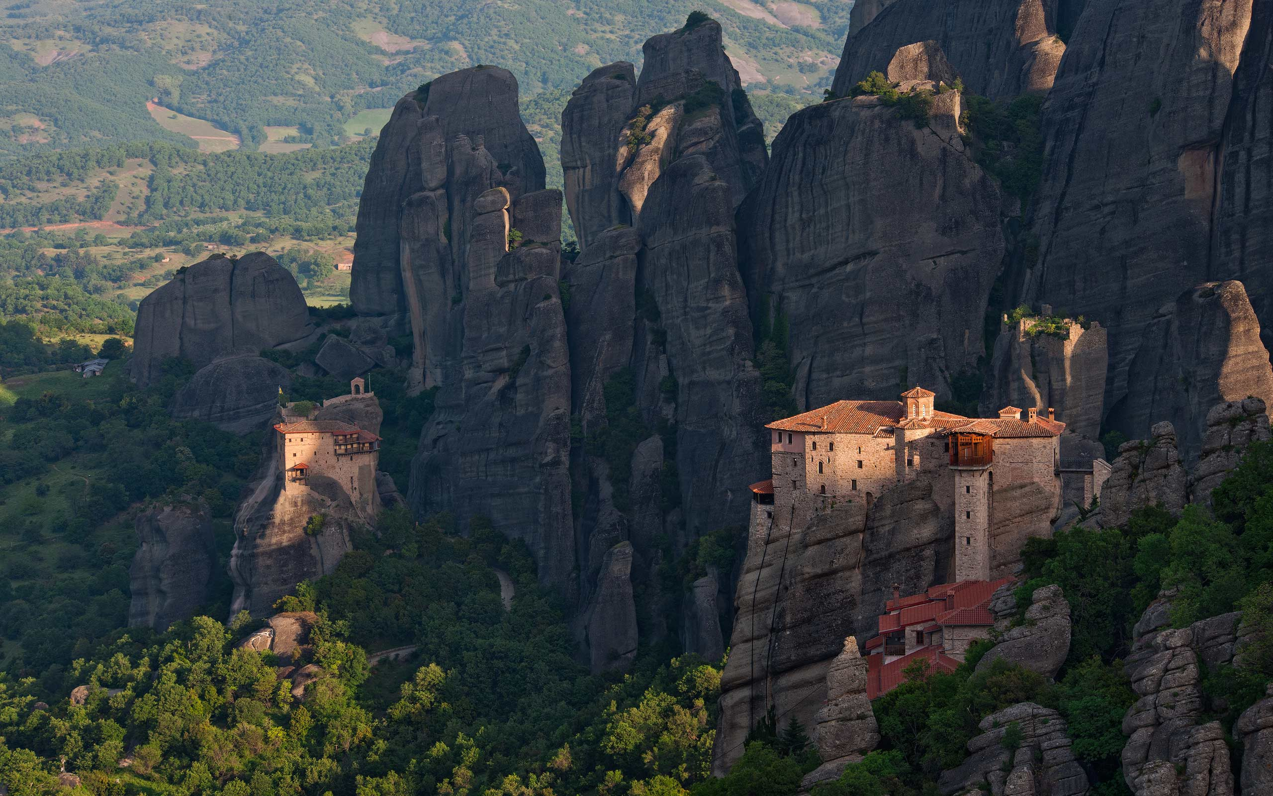 Roussanou Nunnery and St. Nicholas Anapafsas Monasteriy at sunrise. Meteora, Thessaly, Greece - Meteora-Monasteries-Greece - Mike Reyfman Photography