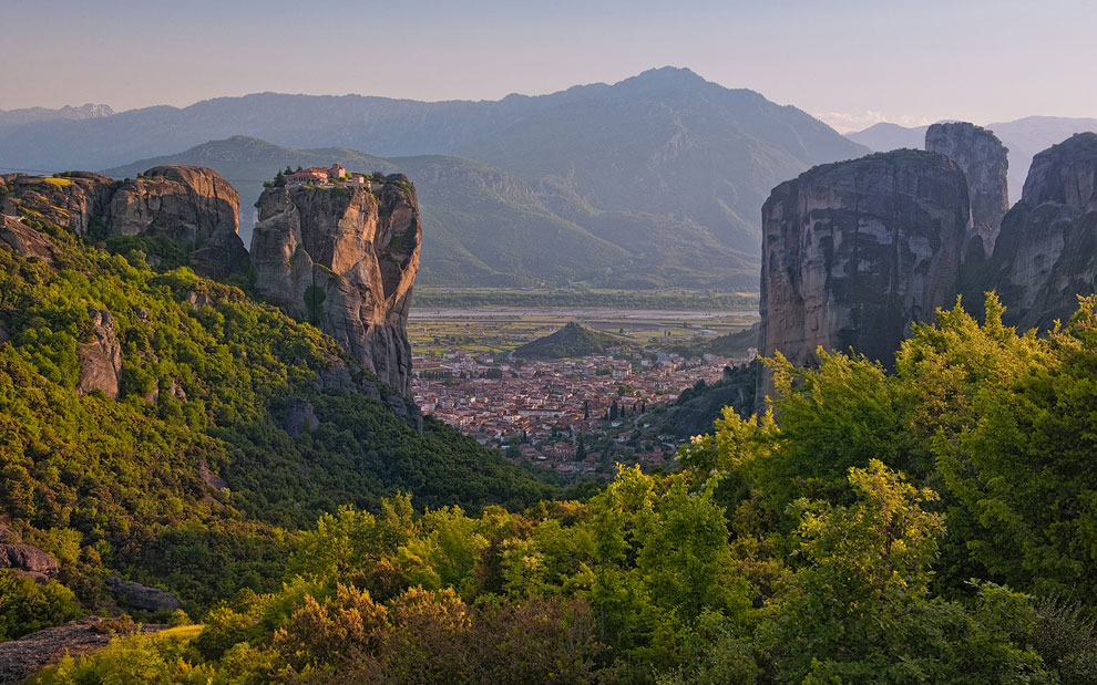 Holy Trinity Monastery (Agia Trias) in the Meteora with the town of Kalambaka on Thessaly valley floor. Greece.