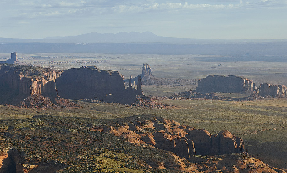 Distant aerial view of Three Sisters in morning haze. Monument Valley, Arizona, USA. - Monument-Valley-Agathla-Peak-El-Capitan-Owl-Church-Rock - Mike Reyfman Photography