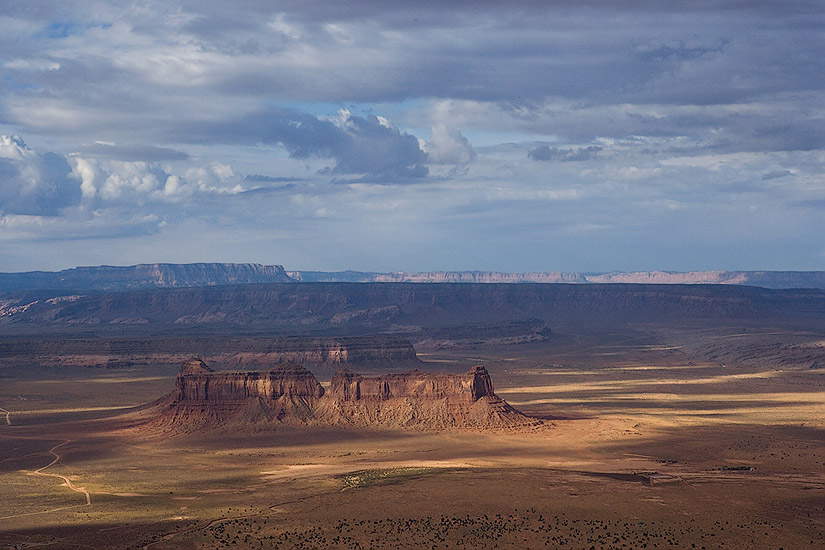 Aerial view of Train Rock under stormy sky. Monument Valley, Arizona, USA. - Monument-Valley-Agathla-Peak-El-Capitan-Owl-Church-Rock - Mike Reyfman Photography