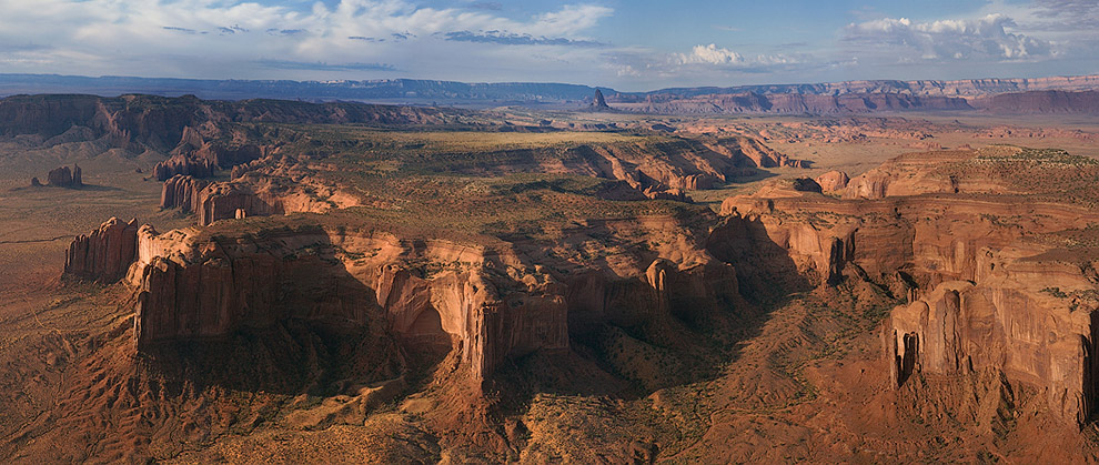 Panoramic aerial view of the Monument Valley with Agathla Peak in a distance. Arizona, USA. - Monument-Valley-Agathla-Peak-El-Capitan-Owl-Church-Rock - Mike Reyfman Photography