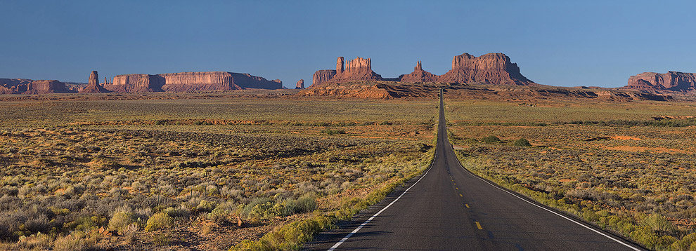 The classic road picture - US 163 approaching Monument Pass from the north. Monument Valley, Arizona, USA. Panoramic. - Monument-Valley-Agathla-Peak-El-Capitan-Owl-Church-Rock - Mike Reyfman Photography