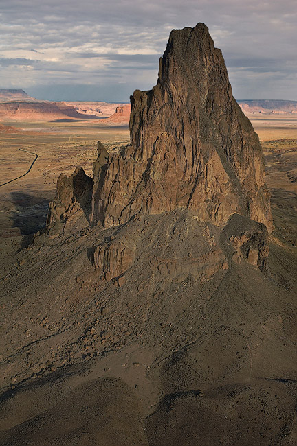 Aerial view of Agathla Peak (El Capitan) and US 163 south of Monument Valley, Arizona, USA. - Monument-Valley-Agathla-Peak-El-Capitan-Owl-Church-Rock - Mike Reyfman Photography