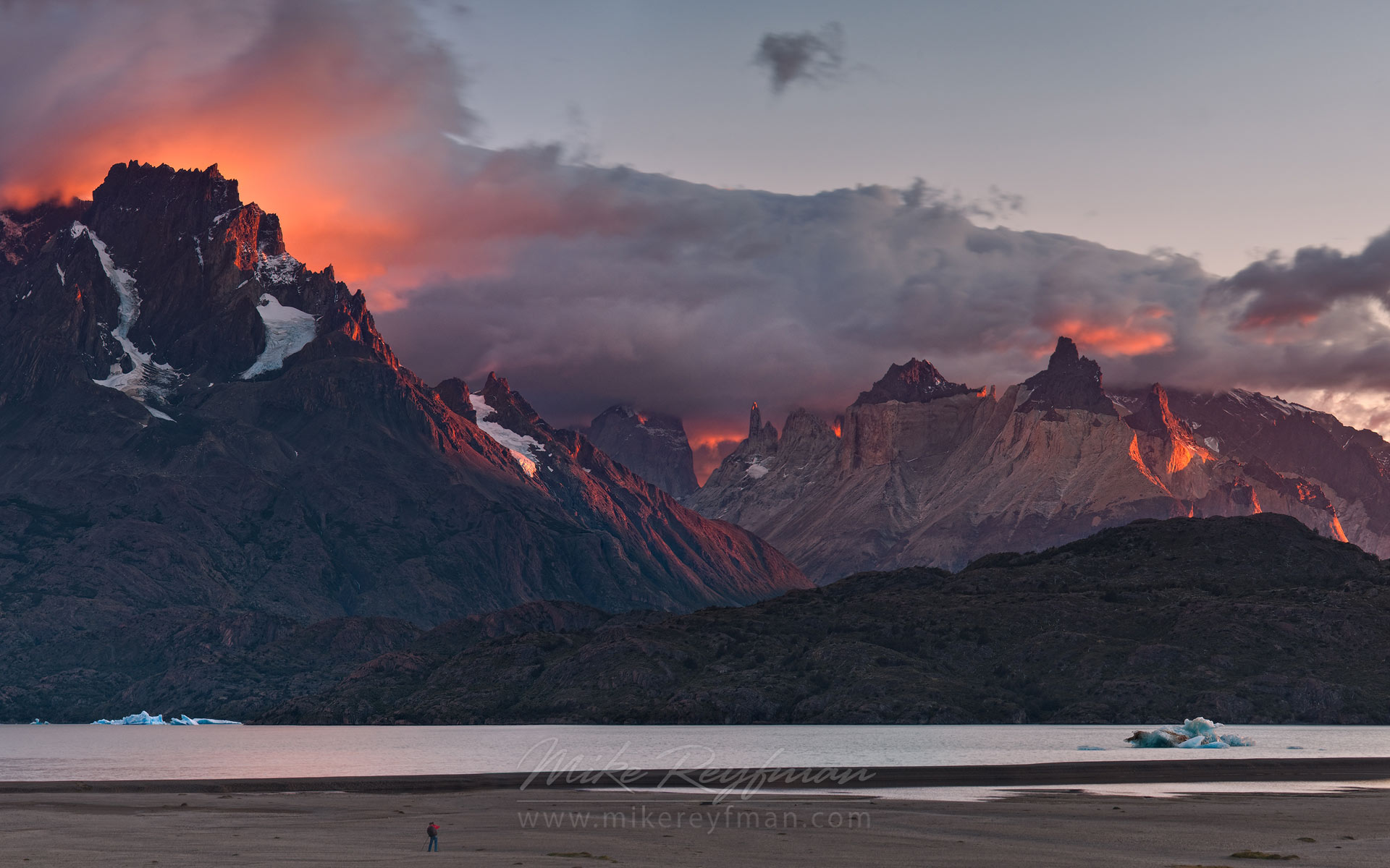 Fiery sunrise on Lago Grey. Cerro Paine Grande and Cuernos del Paine. Torres del Paine National Park, Magallanes and Antartica Chilena Region XII, Patagonia, Chile. - Torres-Del-Paine-National-Park-Patagonia-Chile - Mike Reyfman Photography