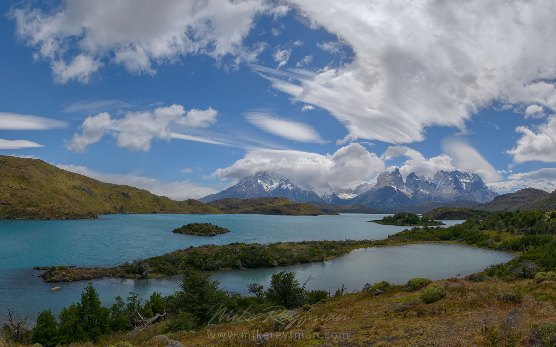 Panoramic view of Lago Pehoe and Cordillera del Paine from Explora Loge. Torres del Paine National Park, Ultima Esperanza Province, Magallanes and Antartica Chilena Region XII, Patagonia, Chile. - Torres-Del-Paine-National-Park-Patagonia-Chile - Mike Reyfman Photography