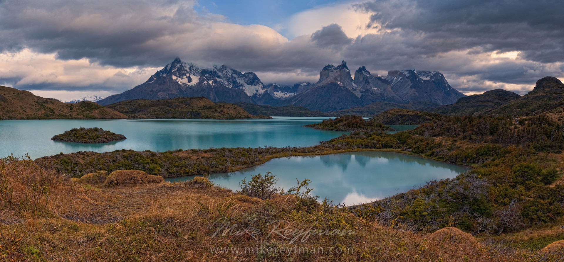 Lago Pehoe, Cerro Paine Grande and Cuernos del Paine from Explora Loge. Torres del Paine National Park, Ultima Esperanza Province, Magallanes and Antartica Chilena Region XII, Patagonia, Chile. - Torres-Del-Paine-National-Park-Patagonia-Chile - Mike Reyfman Photography