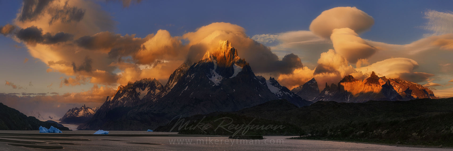 Fiery sunset over Cordillera del Paine. Panoramic view of Lago Grey, Cerro Paine Grande and Cuernos del Paine. Torres del Paine National Park, Patagonia, Chile. - Torres-Del-Paine-National-Park-Patagonia-Chile - Mike Reyfman Photography