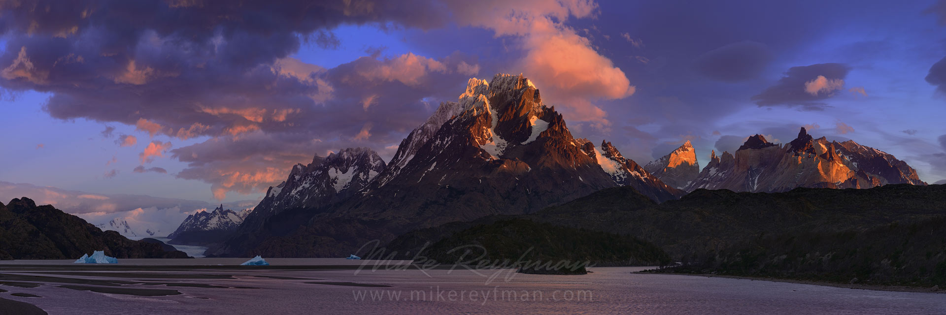 Windy sunrise over Cordillera del Paine. Panoramic view of Lago Grey, Cerro Paine Grande and Cuernos del Paine. Torres del Paine National Park, Patagonia, Chile. - Torres-Del-Paine-National-Park-Patagonia-Chile - Mike Reyfman Photography