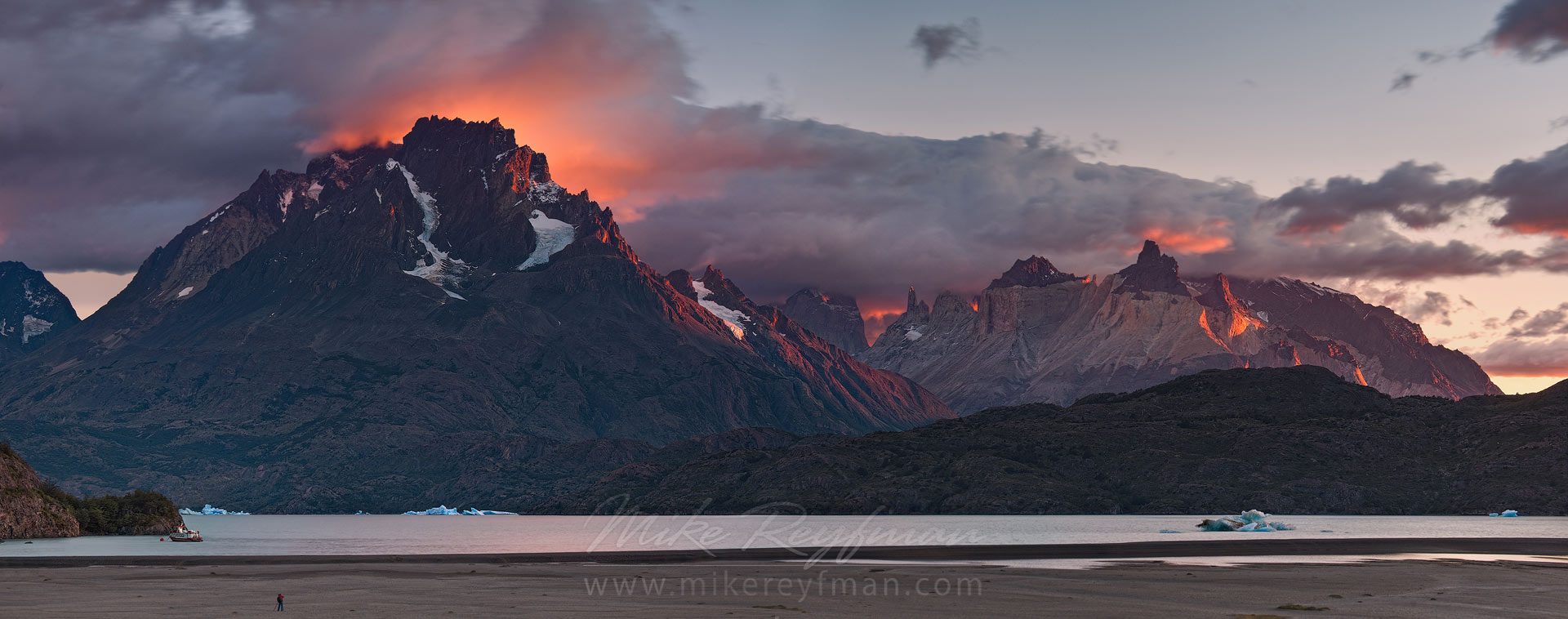 Sunrise at Lago Gray. Cerro Paine Grande and Cuernos del Paine in dramatic sunrise lighting. Torres del Paine National Park, Magallanes and Antartica Chilena Region XII, Patagonia, Chile. - Torres-Del-Paine-National-Park-Patagonia-Chile - Mike Reyfman Photography