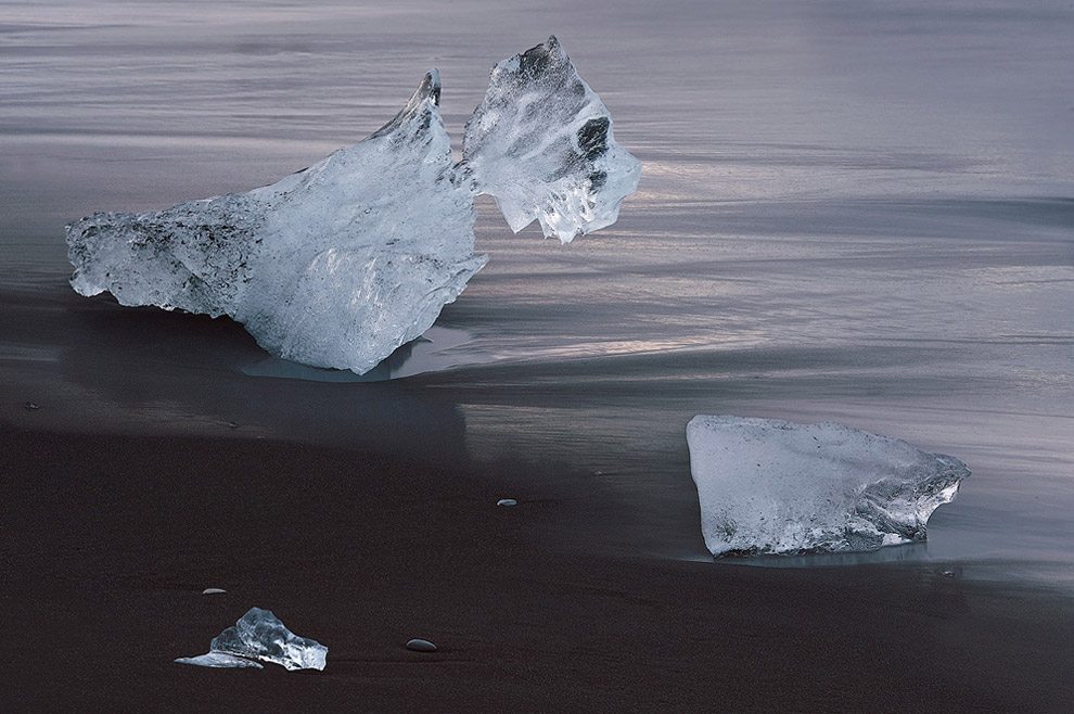 Awaiting of Inevitable. Iceberg on the Ocean coast near Jokulsarlon Glacial Lagoon, Iceland.