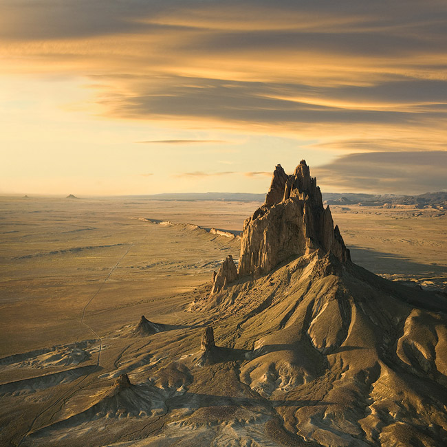 The Amber Chronicles. Shiprock or Tse Bi dahi (Rock with Wings), Four Corners Area, New Mexico, USA. Aerial.