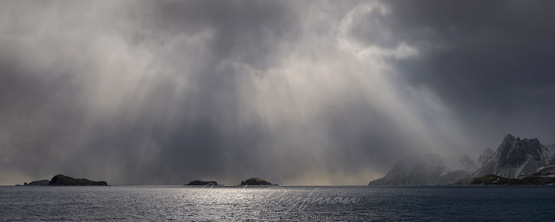 Dramatic light over small islands. South Georgia, Sub Antarctic. - Albatrosses-Petrels-Landscapes-South-Georgia-Sub-Antarctic - Mike Reyfman Photography