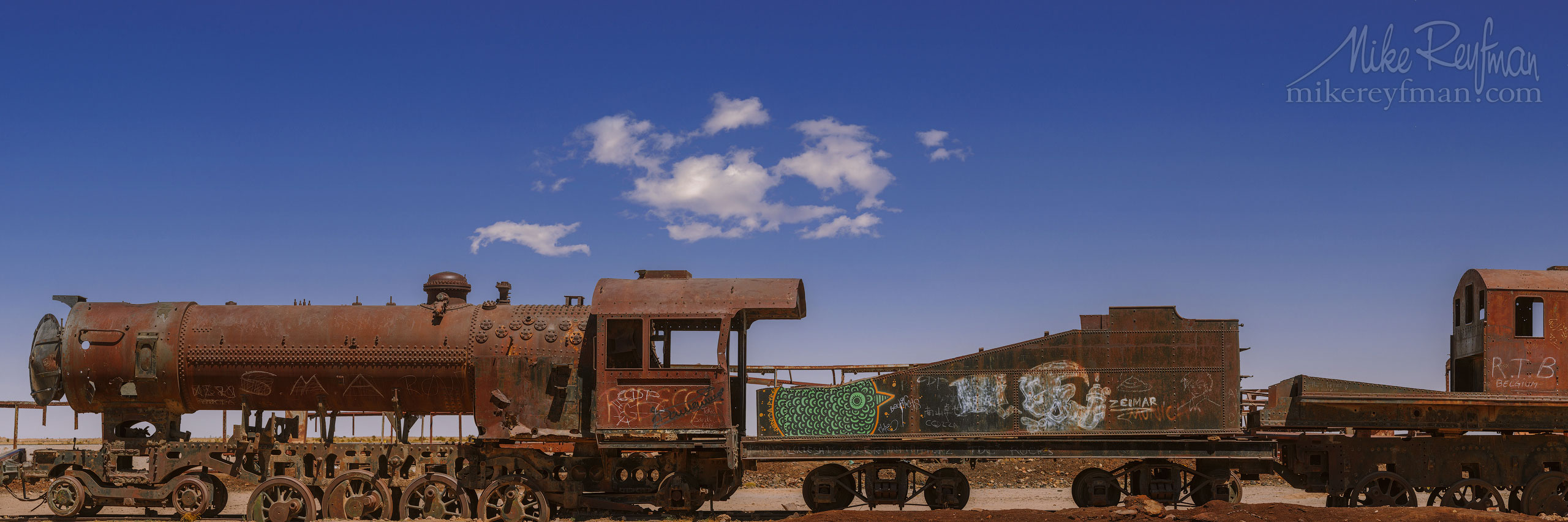 The ''Cementerio de trenes'', the antique train cemetery. Salar de Uyuni, Altiplano. Daniel Campos Province, Potosí, Bolivia AA1-AIR2065_Pano_1x3_6 - Atacama and Altiplano. The Driest Desert and The High Plain - Mike Reyfman Photography