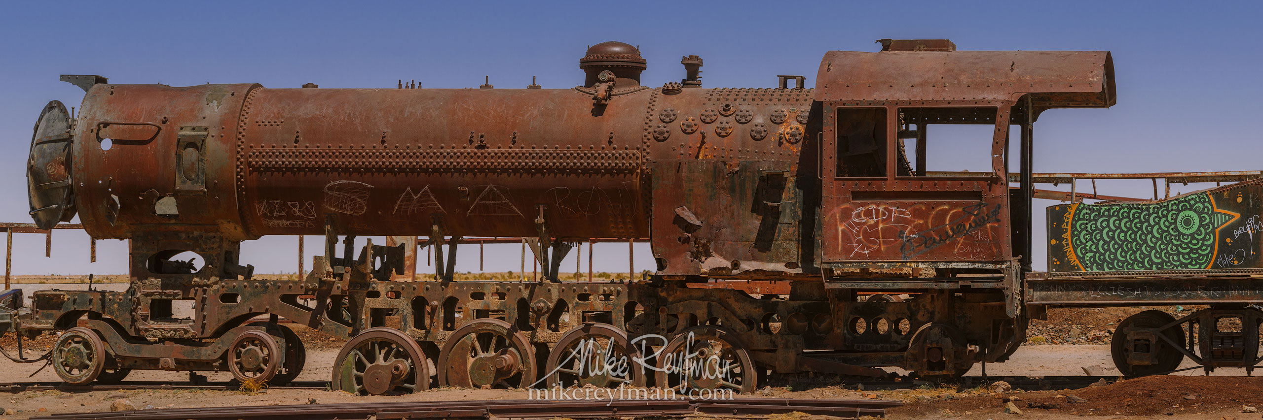 The ''Cementerio de trenes'', the antique train cemetery. Salar de Uyuni, Altiplano. Daniel Campos Province, Potosí, Bolivia AA1-AIR2065_Pano_1x3_3 - Atacama and Altiplano. The Driest Desert and The High Plain - Mike Reyfman Photography
