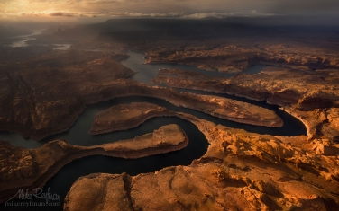 Sunset-on-Planet-Earth.-Confluence-of-San-Juan-&-Colorado-Rivers.-Glen-Canyon-NRA,-Lake-Powell,-Utah/Arizona,-USA.-Aerial.