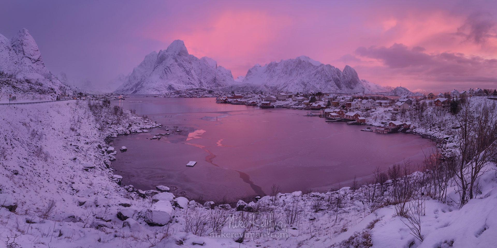 Arctic Morning. Panoramic view of Olstinden mountain peak and fishing village of Reine at sunrise. Moskenes, Lofoten archipelago, Norway. LF-MRD1E0840-46_Pano-2x1 - Lofoten Archipelago in Winter, Arctic Norway - Mike Reyfman Photography