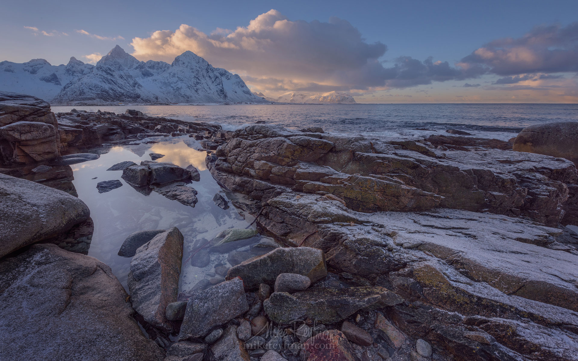 Vareid Shoreline and Jagged snow capped peaks of Flakstad Fjord before sunset. Vareid, Flakstadoya island, Lofoten archipelago, Nordland, Norway. LF-MRD1E0393 - Lofoten Archipelago in Winter, Arctic Norway - Mike Reyfman Photography