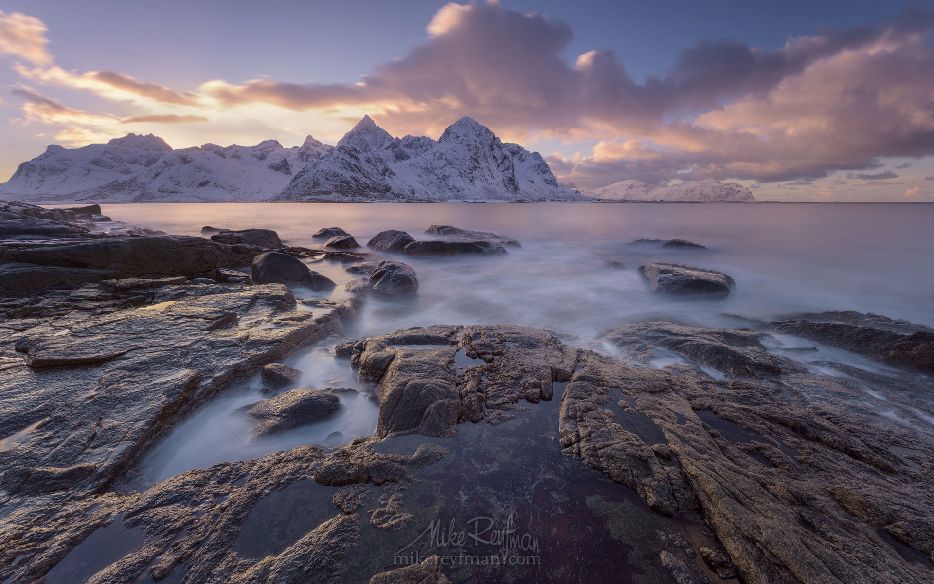 Vareid Shoreline and Jagged snow capped peaks of Flakstad Fjord before sunset. Vareid, Flakstadoya island, Lofoten archipelago, Nordland, Norway. LF-MRD1E0445 - Lofoten Archipelago in Winter, Arctic Norway - Mike Reyfman Photography