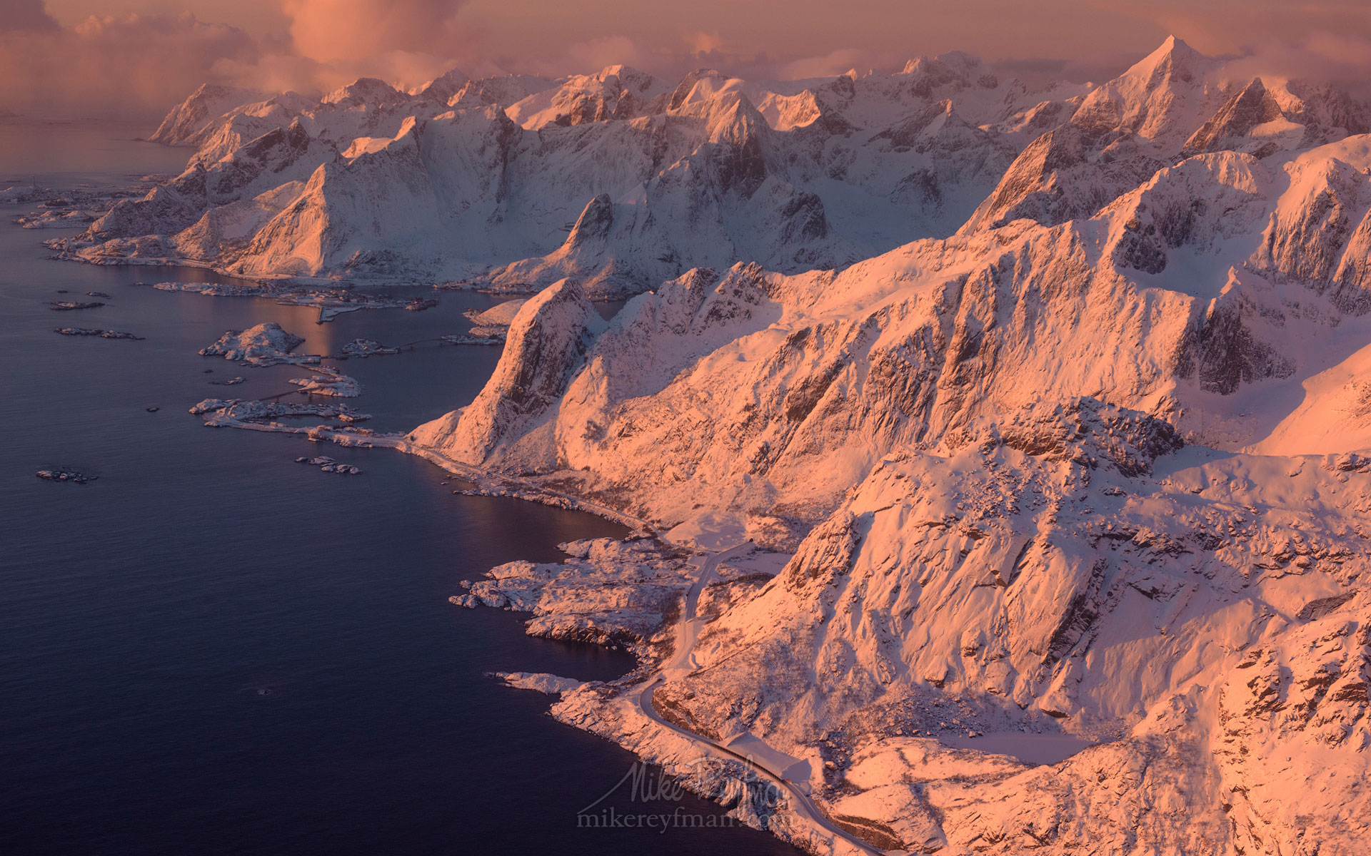 Aerial view of Lofoten archipelago and fishing village of Reine at sunrise. Moskenesoya Island, Lofoten archipelago, Norway. LF-MRD1E1449 - Lofoten Archipelago in Winter, Arctic Norway - Mike Reyfman Photography