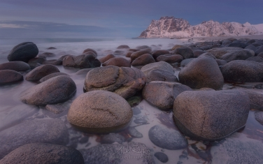 Round-boulders-on-Utakleiv-beach-after-sunset.-Vestvagoy,-Lofoten-Islands,-Norway