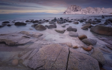 Boulders-on-Utakleiv-beach-after-sunset.-Vestvagoy,-Lofoten-Islands,-Norway