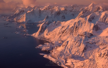 Aerial-view-of-Lofoten-archipelago-and-fishing-village-of-Reine-at-sunrise.-Moskenesoya-Island,-Lofoten-archipelago,-Norway.