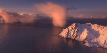 Dancing-Clouds-phenomena.-Aerial-view-of-Lofoten-archipelago-at-sunrise.-Moskenes,-Lofoten-archipelago,-Norway.