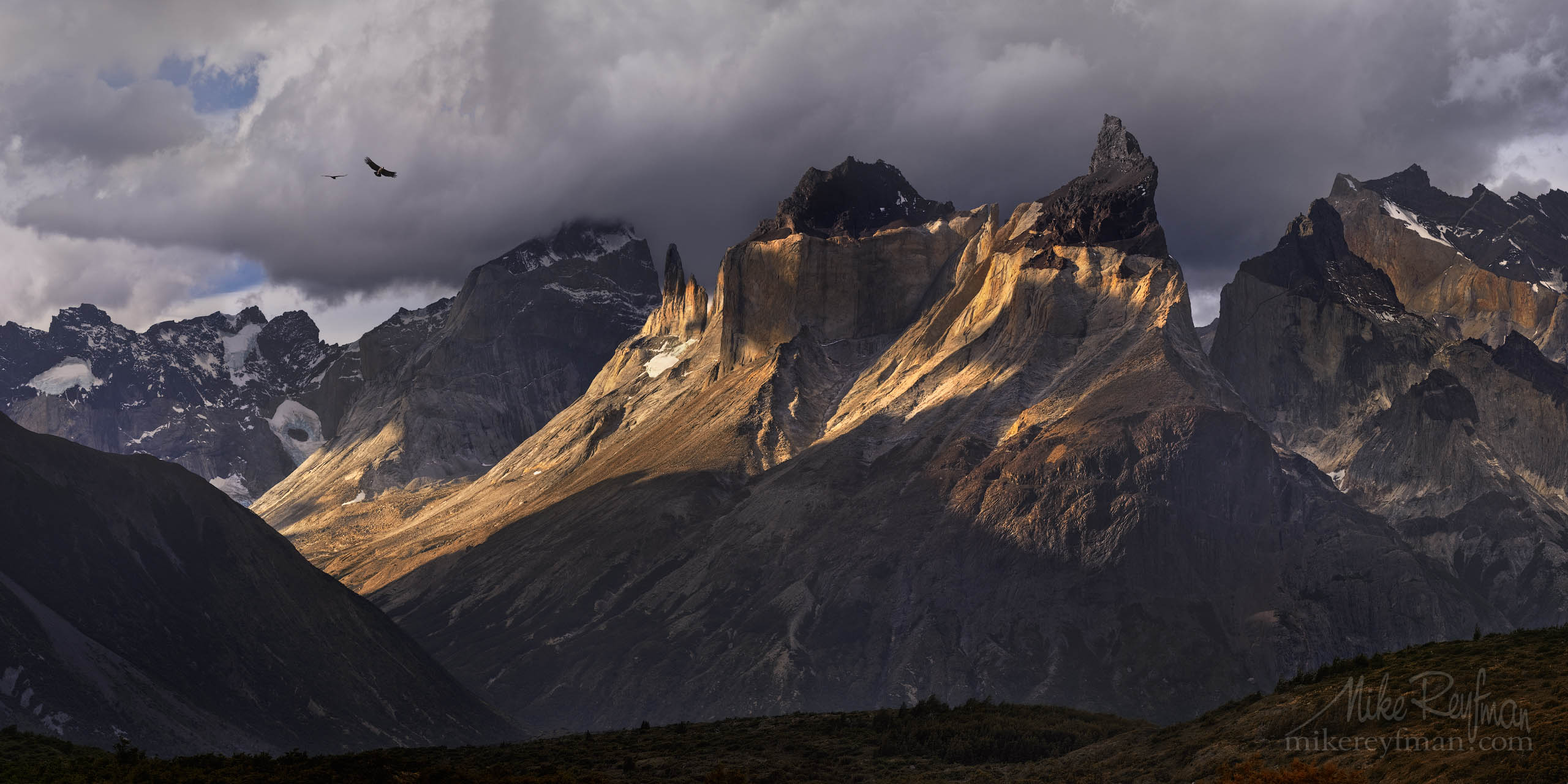 Condors soaring over Cordillera del Paine. Torres del Paine National Park, Ultima Esperanza Province, Magallanes and Antartica Chilena Region XII, Patagonia, Chile. P12-MR47304-10-Pano - Selected panoramic images with 2:1 aspect ratio - Mike Reyfman Photography
