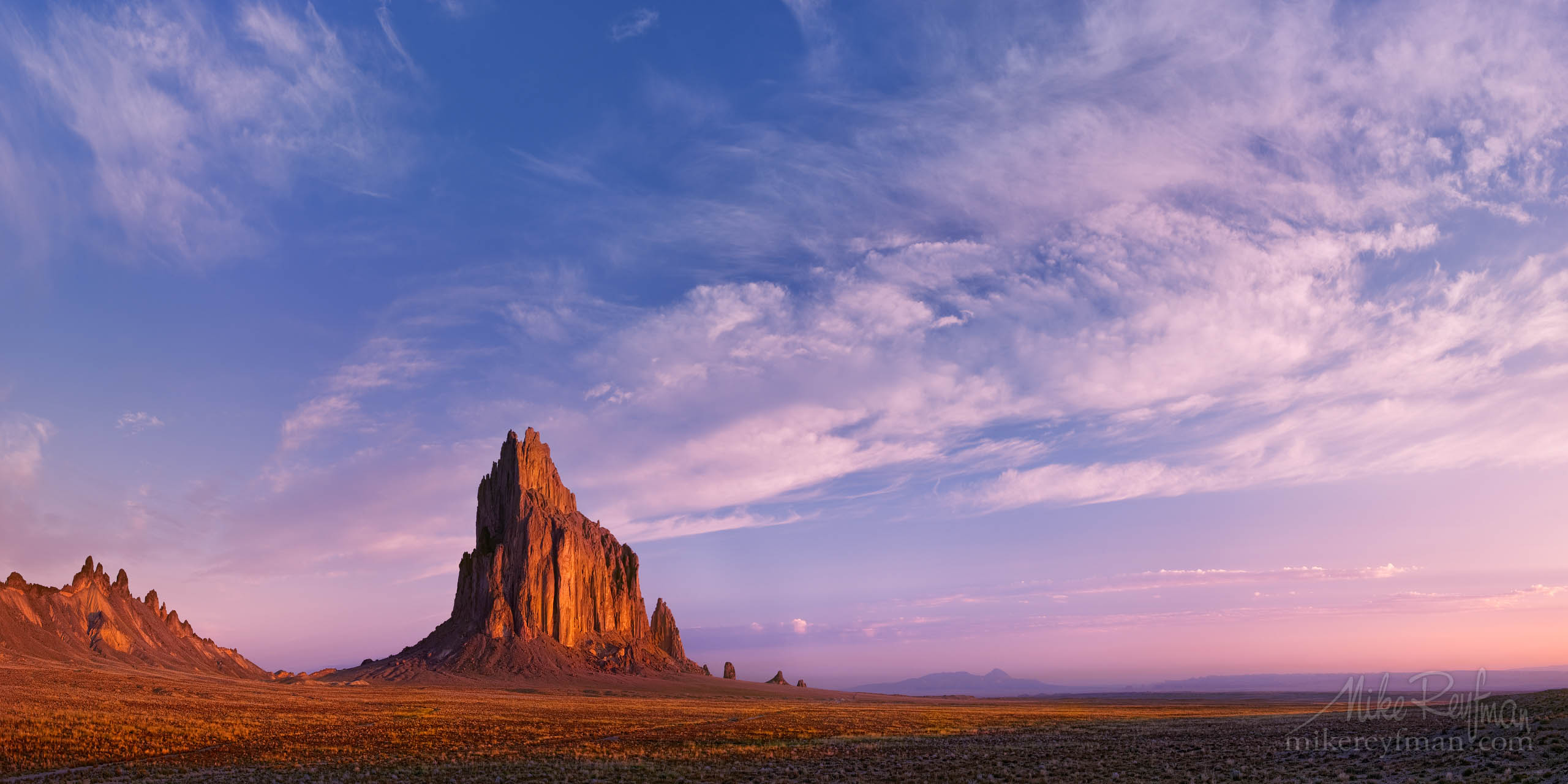 The Chronicles of Amber (shortest – 50 words)Shiprock (Tse Bi Dahi  or Rock with Wings) - the 1700-foot eroded volcanic plug that sacred to Navajo People. In that morning Navajo gods were benevolent, and on usually deserted sky floated clouds. P12-MRO3X7894-96-Pano - Selected panoramic images with 2:1 aspect ratio - Mike Reyfman Photography
