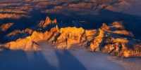 Granite-spires-of-Cerro-Torre-massif-and-mount-Fitzroy-massif-at-sunset.-Viedma-Glacieron---the-part-of-the-Southern-Patagonia-ice-cap-on-the-foreground.-Taken-on-the-LAN-flight-from-Río-Gallegos-to-Punta-Arenas.