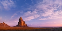 The-Chronicles-of-Amber-(shortest-–-50-words)Shiprock-(Tse-Bi-Dahi--or-Rock-with-Wings)---the-1700-foot-eroded-volcanic-plug-that-sacred-to-Navajo-People.-In-that-morning-Navajo-gods-were-benevolent,-and-on-usually-deserted-sky-floated-clouds.