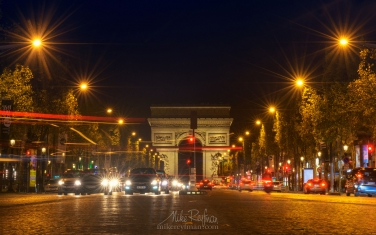 The-Avenue-des-Champs-Élysées-and-the-Arc-de-Triomphe-at-night