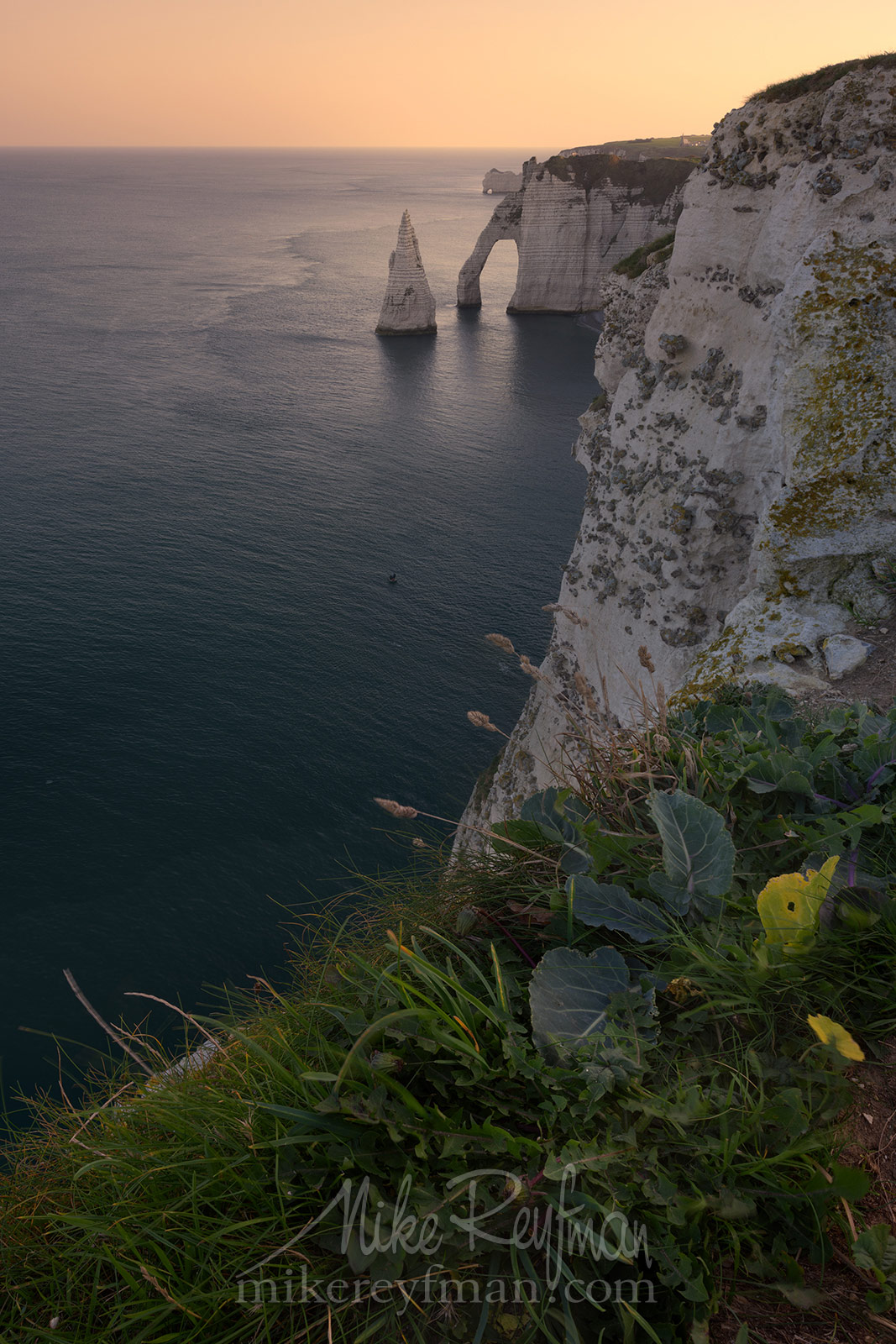 Arch Porte d'Aval and L'Aiguille - the Needle with the Porte d'Amont arch in the distance. Cote d'Albatre – The Alabaster Coast. Ertretat, Normandy, France ET1-MR50A0229 - White Chalk Cliffs and Arches of Alabaster Coast. Etretat, Upper Normandy, France - Mike Reyfman Photography